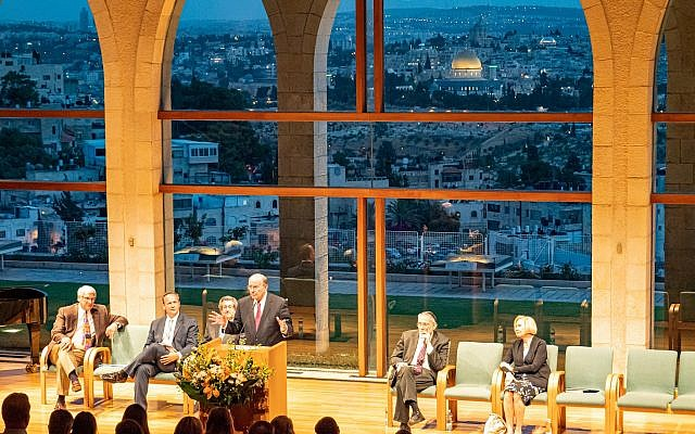 (Photo credit: Intellectual Reserve) Elder Quentin L. Cook of the Quorum of the Twelve Apostles delivers a keynote address during the Jewish - Latter-day Saint Academic Dialogue conference in Israel.  Seated (left to right):  Dr. James Kearl, Assistant to the University President for the BYU Jerusalem Center, BYU Prof. Shon Hopkin, Rabbi Mark Diamond, keynote speaker Rabbi Michael Melchior, Sister Mary Cook