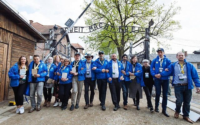 March of the Living group at Auschwitz notorious gate. Credit: Sam Churchhill Photography via Jewish News