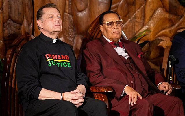 Father Michael Pfleger sits next to Louis Farrakhan of the Nation of Islam before they both speak at Saint Sabina Church, May 9, 2019, in Chicago. (Ashlee Rezin/Chicago Sun-Times via AP)