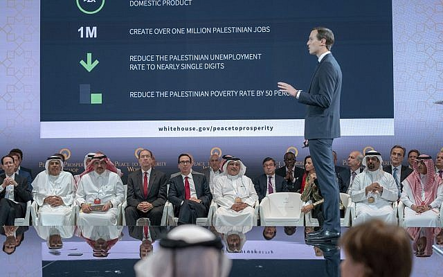 US Treasury Secretary Steven Mnuchin, fifth from left, and Bahrain Crown Prince Salman bin Hamad Al Khalifa, sixth from left, listen to White House senior adviser Jared Kushner, standing, during the opening session of the 'Peace to Prosperity' workshop in Manama, Bahrain on June 25, 2019. (Bahrain News Agency via AP)