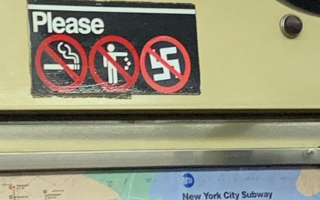 The sign in the New York City subway car. (courtesy)