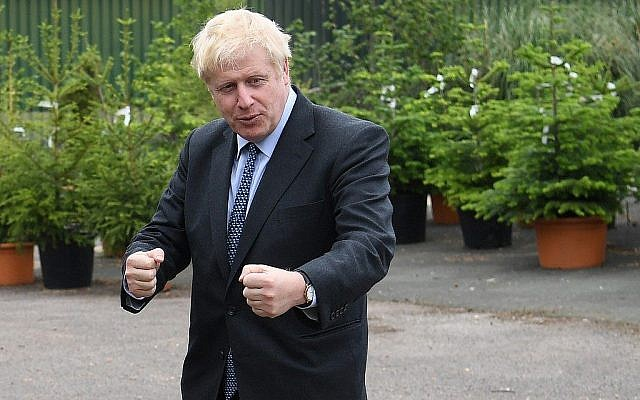 Conservative MP and leadership contender Boris Johnson gestures during a leadership campaign visit to a nursery in Braintree, southeast England, on July 13, 2019. (Neil Hall/Pool/AFP)