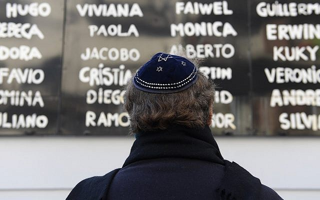 A man prays in front of the Argentine Israelite Mutual Association (AMIA) Jewish community center during the commemoration of the 23rd anniversary of the terrorist bombing attack that killed 85 people and injured 300, in Buenos Aires on July 18, 2017. (AFP / Juan Mabromata / Getty Images)