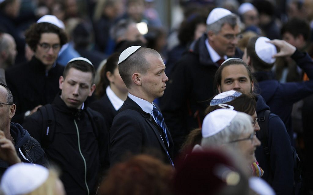 In this April 25, 2018 file photo, people wear Jewish skullcaps, as they attend a demonstration against an anti-Semitic attack in Berlin. (AP/Markus Schreiber)
