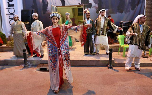 Dancers wearing traditional Iraqi folk costume perform during World Refugee Day in Baghdad, Iraq, Thursday, June 20, 2019. (AP Photo/Hadi Mizban)