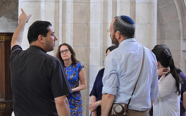 Dean Hosam Naoum shows the group round St George's Anglican Cathedral, Jerusalem