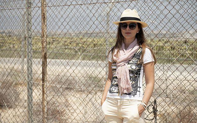 Vlora Çitaku poses for a selfie along Israel's heavily fortified border with Gaza.