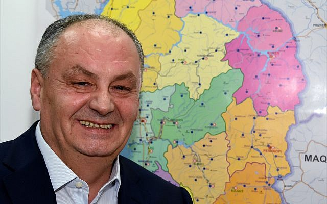 Bardhyl Canaj, Albania's ambassador to Israel, in front of a map of his Balkan country. (Larry Luxner)