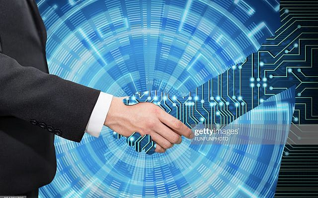 Businessman shaking hand with digital partners hand on blue futuristic background.