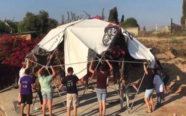 A geodesic dome designed and constructed by Aderet mechina students to create communal hang-out space on the Kfar Ayanot Campus. The roof is made from repurposed tarp.