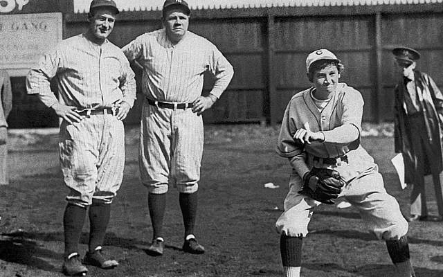 Yankee teammates Lou Gehrig, left, and Babe Ruth study the form of 17-year old Chattanooga Lookouts minor league pitcher Jackie Mitchell, one of the first women to play professional baseball, at an exhibition game on  April 2, 1931, in Chattanooga. With a sharp breaking ball, Mitchell thrilled the local fans by striking out both Ruth and Gehrig, back-to-back, in the first inning. Judge Kenesaw Mountain Landis, the baseball commissioner, voided Mitchell's contract shortly after the exhibition, saying baseball was 'too strenuous' for women. (AP Photo/File)