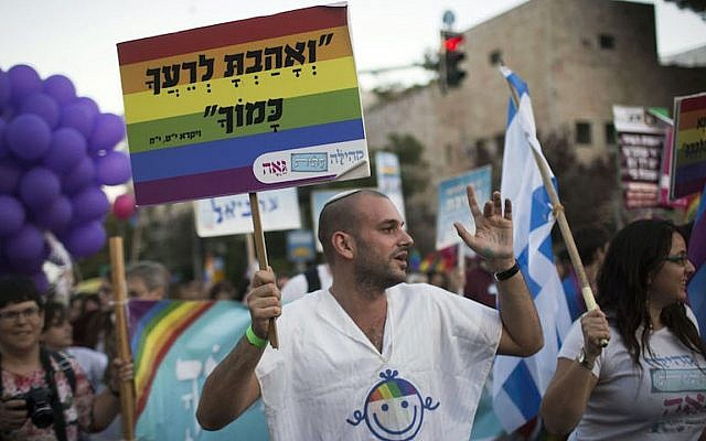 Thousands of people march during the annual Gay Pride parade at a main street in Jerusalem on September 18, 2014. (Hadas Parush/Flash90)