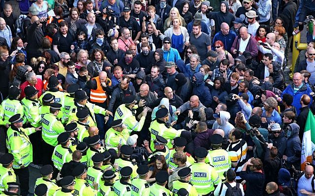 Police stopping anti-fascist protesters from clashing with far-right National Action members   (Jewish News - Photo credit: Peter Byrne/PA Wire)