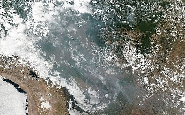 Wikipedia, smoke from the wildfires seen by satellite. Image Courtesy: NASA Worldview, Earth Observing System Data and Information System (EOSDIS).