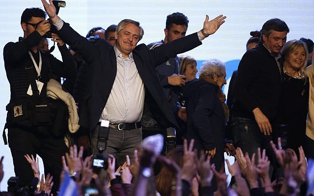 "Presidential candidate Alberto Fernandez addresses supporters at the ""Frente de Todos"" party headquarters after primary elections in Buenos Aires, Argentina, Sunday, Aug. 11, 2019.  (AP Photo/Sebastian Pani)"
