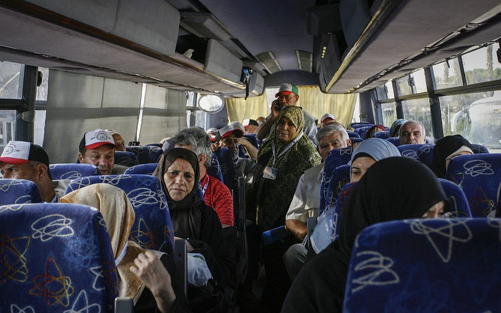 Palestinian Muslim pilgrim on a bus at the Rafah border crossing with Egypt as they head to the annual Hajj pilgrimage in the Muslim holy city of Mecca on September 18, 2014. (Abed Rahim Khatib/Flash90)