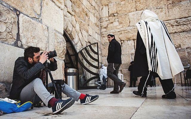 At the Western Wall,  Romanian photographer, Gabriel. Photograph by Tim Mossholder.