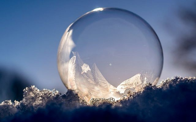 The moon reflected in a frozen bubble. (Public Domain/ PxHere)