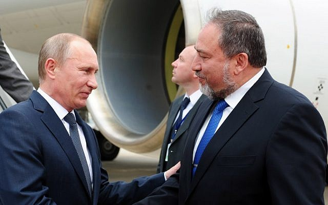 Foreign Minister Avigdor Liberman greets Russian President Vladimir Putin at the Ben Gurion airport, June 25, 2012. (Kobi Gideon/ GPO/File)