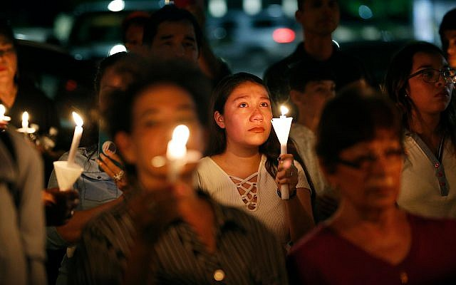 Illustrative. People attend a candlelight vigil for victims of a mass shooting at a shopping complex over the weekend, August 5, 2019, in El Paso, Texas. (AP Photo/John Locher)