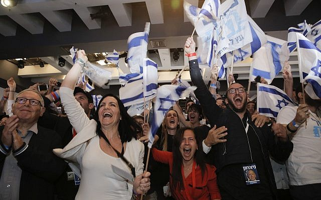 Blue and White part supporters cheer at the party's campaign headquarters after polls for Israel's general elections closed, in Tel Aviv, Tuesday, April 9, 2019. (AP Photo/Sebastian Scheiner via Jewish News)