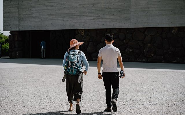 Photo of my Jewish-Israeli tour guide and I at Yad Vashem when we led a group of Asian-American college students through Passages. PC: Harrison Yu.