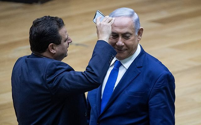 Arab-Israeli MK Ayman Odeh films Israeli PM Benjamin Netanyahu with his phone in protest at the proposed law to allow cameras in polling stations (BICOM via Jewish News)
