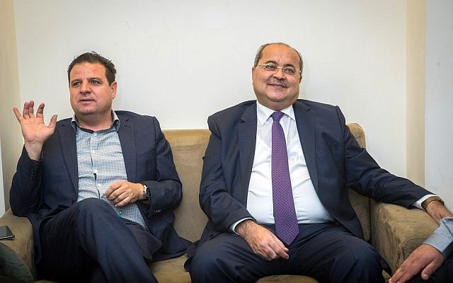 Leader of the Joint list Ayman Odeh (L) and party member Ahmad Tibi meet at the Knesset on September 22, 2019, ahead of their meeting with the President where they will give their recommendation for who will be given the mandate to build the next coalition following the elections. (Yonatan Sindel/Flash90)