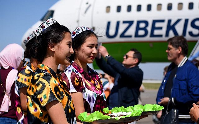 Local women in traditional costume greet VIP passengers arriving on an Uzbekistan Airways charter flight from Tashkent to the country's southernmost city, Termez. (Larry Luxner)