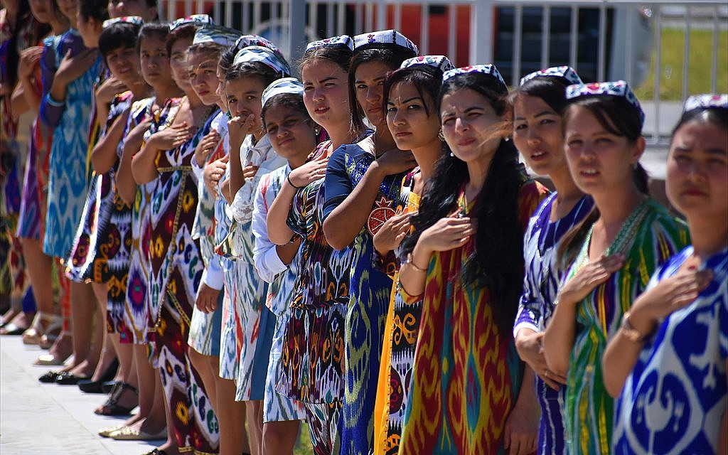 Local Uzbek girls line up to greet arriving dignitaries at Termez International Airport. (Larry Luxner)