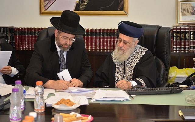 Illustrative. Ashkenazi Chief Rabbi David Lau (L) and Sephardi Chief Rabbi Yitzhak Yosef convene an emergency meeting against a new proposal to overhaul the conversion to Judaism system in the country on June 3, 2018. (courtesy, the Chief Rabbinate spokesperson)