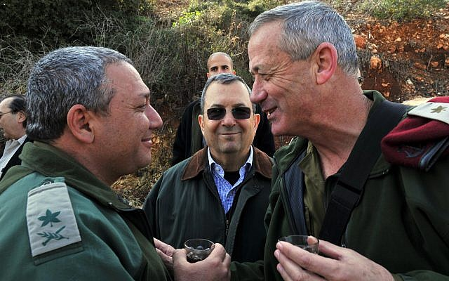 Then-defense minister Ehud Barak (center), then-IDF chief of staff Benny Gantz (right),  and Gantz's successor in the role Gadi Eisenkot, pictured near the northern border on February 15, 2011. (Defense Ministry/ Flash90/ File)