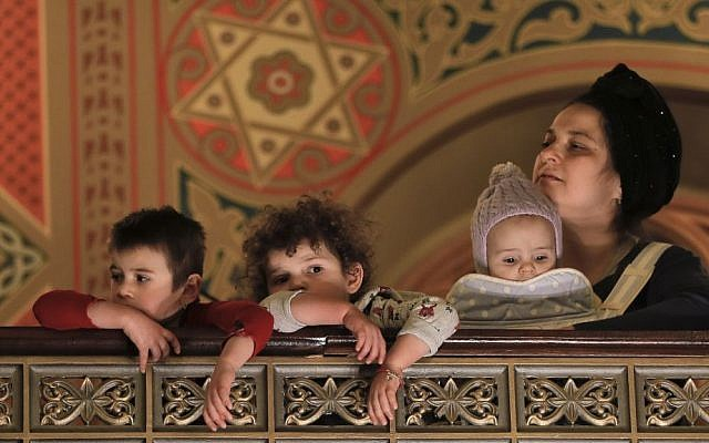 Children attend Purim celebrations at the Coral Temple synagogue in Bucharest, Romania. Children put on fancy costume dress joining dozens of believers from Romania's Jewish community who attended a Purim service to celebrate the Jews' salvation from genocide in ancient Persia, as recounted in the Book of Esther, March 11, 2017. (AP Photo/Vadim Ghirda)