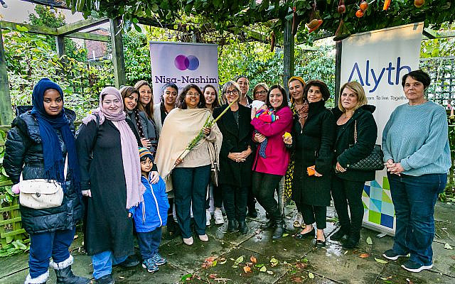 Jewish and Muslim women in a show of unity after the Halle terror attack, with Hifsa Haroon-Iqbal in the centre holding a lulav and etrog.  (Yakir Zur via Jewish News)