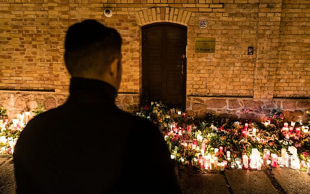A man views a makeshift memorial at the entrance to the synagogue in Halle, Germany, October 10, 2019. (Jens Schlueter/Getty Images)