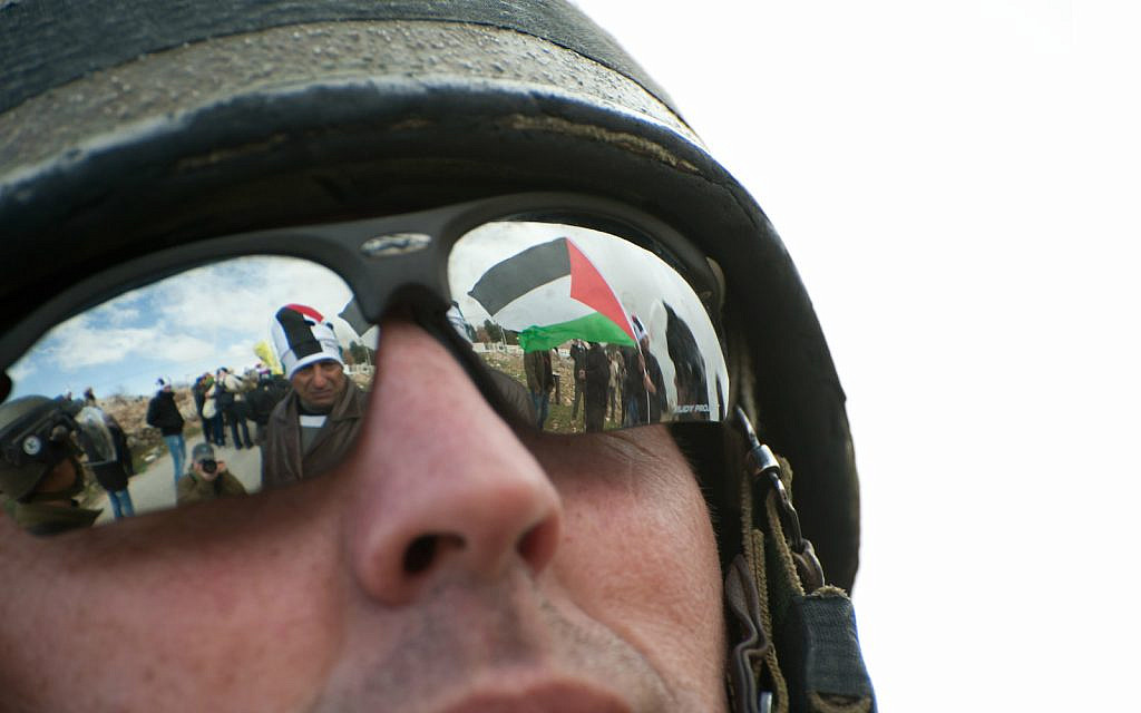 Illustrative: Israeli soldier at a demonstration against the separation barrier in the West Bank town of Al-Masara. January 27, 2012 (iStock)