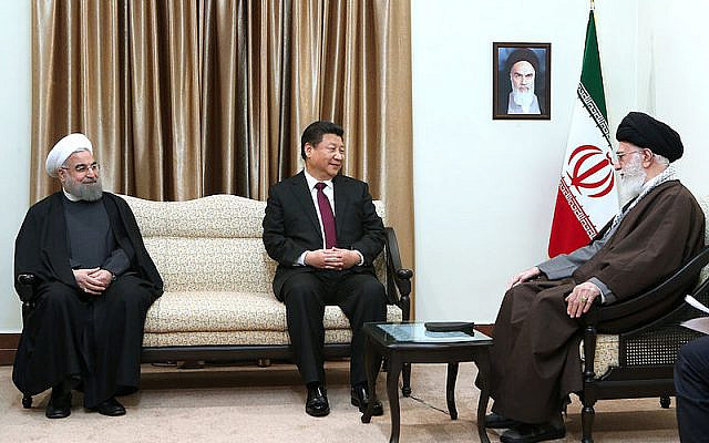Chinese president Xi Jinping with Ali Khamenei (right) and president Hassan Rouhani. Ayatolla Khomeini is in the portrait on the wall  (BICOM/Jewish News)