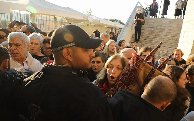 WOW Chairperson Anat Hoffman attempts to enter the Western Wall Plaza with a Torah scroll on Rosh Hodesh Heshvan 2019, and faces obstacles from security personnel. (SS Photography)