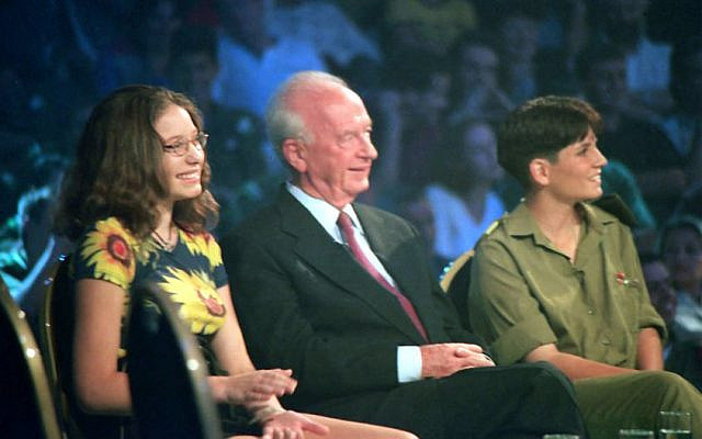 Sivan Rahav (left) aged 14, together with Yitzhak Rabin, on the Dan Shilon Live program, in honor of the Jewish New Year, September 1995. (Wikipedia)