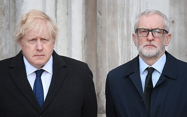 Britain's Prime Minister Boris Johnson (L) and opposition Labour party leader Jeremy Corbyn take part in a vigil at the Guildhall in central London to pay tribute to the victims of the London Bridge terror attack on December 2, 2019. (Photo by DANIEL LEAL-OLIVAS / AFP)