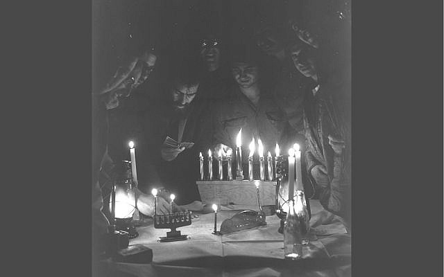 Illustrative: Soldiers light Hanukkah candles in their tent in the West Bank of the Suez Canal during the Yom Kippur War. December 23, 1973 (Government Press Office)