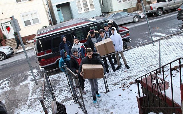 Students from Manhattan's Ramaz School deliver Hanukkah gifts for children in the Satmar Jewish community in Jersey City, following a the deadly shooting attack on a kosher market. (Facebook)