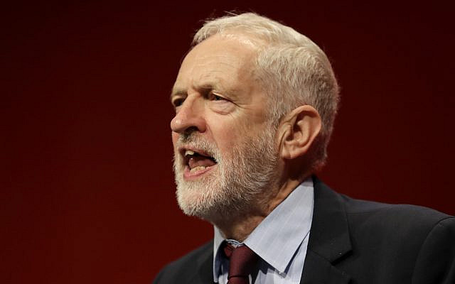 Jeremy Corbyn, leader of Britain's opposition Labour Party, gives an impromptu speech during the Labour Party Conference at the Brighton Centre in Brighton, England. Sept. 24, 2019. (AP Photo/Kirsty Wigglesworth, File)