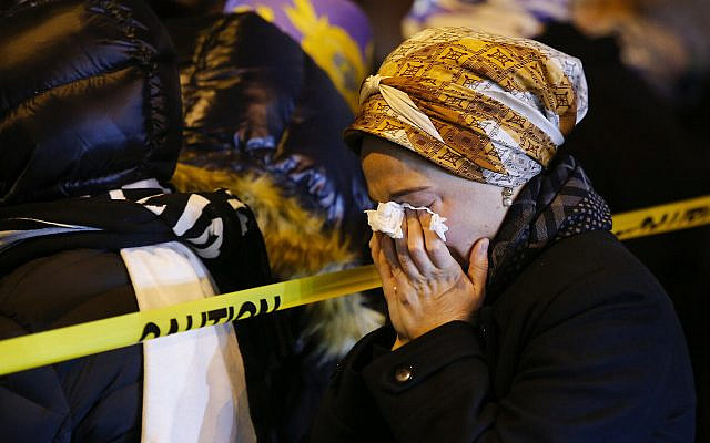 Women mourn during the funeral service of Mindel Ferencz, who was killed in a shooting at a kosher market in Jersey City, New Jersey, December 11, 2019. (AP Photo/Eduardo Munoz Alvarez)