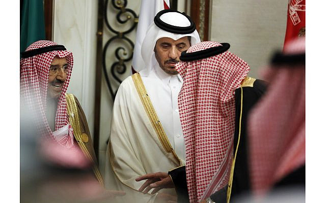 Qatar's Prime Minister Abdullah bin Nasser bin Khalifa al-Thani, center, looks at Saudi King Salman, right, as he talks to Kuwait's emir, Sheikh Sabah Al Ahmad Al Sabah, left, during the 40th Gulf Cooperation Council Summit in Riyadh, Saudi Arabia, Tuesday, Dec. 10, 2019.  (AP Photo/Amr Nabil)