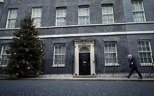 Britain's Prime Minister Boris Johnson returns to 10 Downing Street, on December 13, 2019. Johnson's Conservative Party won a solid majority of seats in Britain's Parliament — a decisive outcome to a Brexit-dominated election that should allow Johnson to fulfill his plan to take the UK out of the European Union next month. (AP Photo/Matt Dunham)