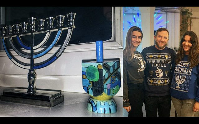 The author's hanukkiyah, dreidel and two co-workers wearing Hanukkah sweaters. (Joe Baur)
