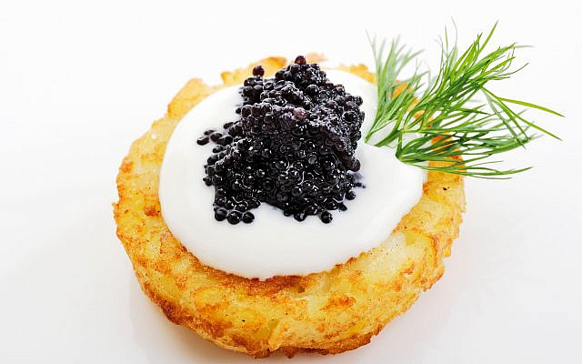 A latke topped with caviar. (Getty Images, via JTA)