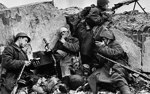 Soviet soldiers at Stalingrad during a short rest after fighting, 1944. (Marc Alpert, RIA Novosti archive, via Wikipedia)
