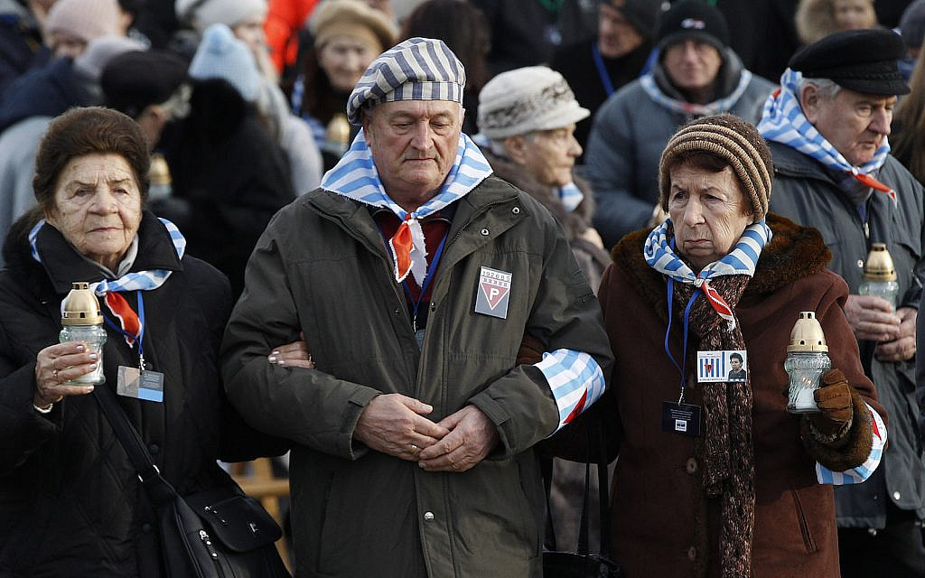 Survivors of Auschwitz arrive at the International Monument to the Victims of Fascism at the former concentration and extermination camp Auschwitz II-Birkenau on International Holocaust Remembrance Day in Oswiecim, Poland, Sunday, Jan. 27, 2019.(AP Photo/Czarek Sokolowski)